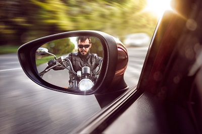 Motorcyclist looking out for other drivers